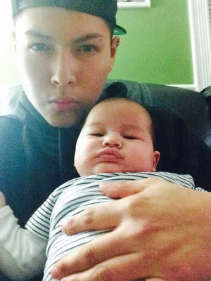 Richard Quezada, 17, who was killed in a Chestnut Ridge motorcycle crash Friday night, with his newborn son, Jayden.