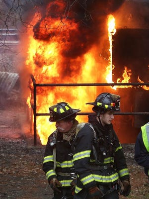 Thornwood firefighters with help from Hawthorne, Valhalla, Pleasantville, Chappaqua and Yonkers, work to contain a fire in a Con Edison substation on Commerce Street in Thornwood Jan. 4, 2015.
