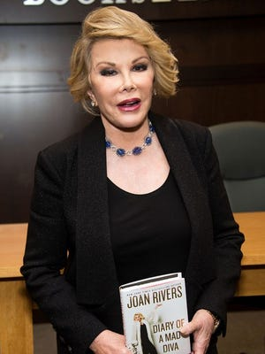Joan Rivers, promoting her book in July, has died, reports say.