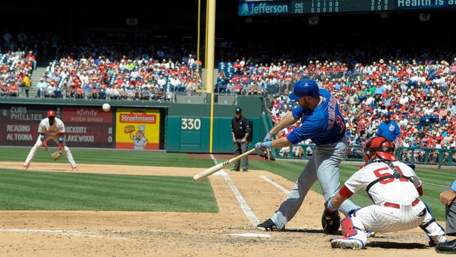 Cubs right fielder Nate Schierholtz hits an RBI double in the sixth inning Sunday against the Phillies at Citizens Bank Park.