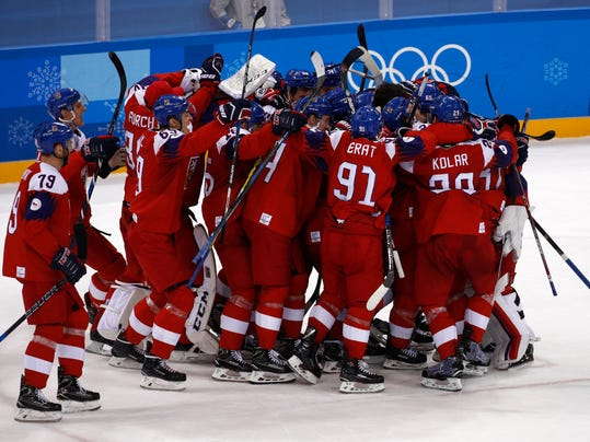 The Czech Republic players celebrate after the quarterfinal round of the men's hockey game against the United States at the 2018 Winter Olympics in Gangneung, South Korea, Wednesday, Feb. 21, 2018. The Czech Republic won 3-2. (AP Photo/Jae C. Hong)