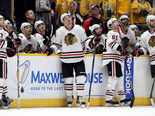 Chicago Blackhawks watch as a goal by the Nashville Predators is reviewed during the third period in Game 4 of a first-round NHL hockey playoff series Thursday, April 20, 2017, in Nashville, Tenn. The goal was ruled good. The Predators won 4-1 and swept the series. (AP Photo/Mark Humphrey)
