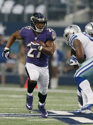 Baltimore Ravens running back Ray Rice (27) runs during the first half of an NFL preseason football game against the Dallas Cowboys Saturday, Aug. 16, 2014, in Arlington, Texas. (AP Photo/Brandon Wade)