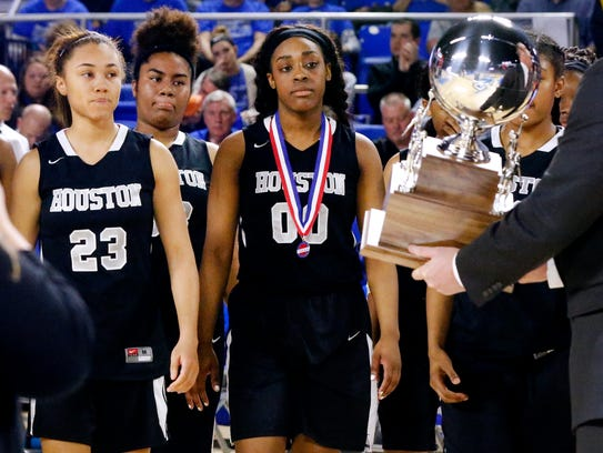 Houston players walk up to receive the runner up trophy