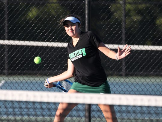 Yorktown's Caitlyn Ferrante returns a shot during the