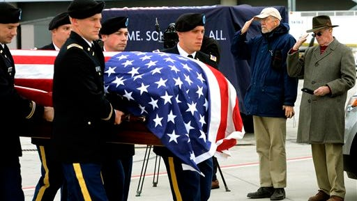 An Army honor guard carries the casket of Maj. Peyton S. Mathis Jr., at the Birmingham-Shuttlesworth International Airport in Birmingham, Ala., Thursday, Jan. 1, 2015.  Mathis died when the airplane he piloted crashed on Guadalcanal in 1944.  His remains were recently identified.  He will be buried in Montgomery Saturday.  (AP Photo/ AL.com, Mark Almond)