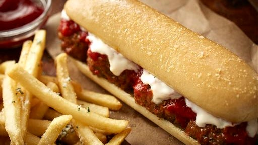 This undated product image provided by Darden Restaurants shows Olive Garden's new meatball breadstick sandwich. The addition of breadstick sandwiches are just the latest attempt to revamp Olive Garden's menu and marketing as sales have declined for the past three of its fiscal years.