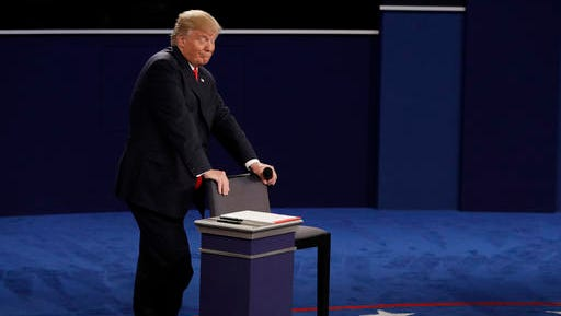 Republican presidential nominee Donald Trump reacts to Democratic presidential nominee Hillary Clinton during the second presidential debate at Washington University in St. Louis, Sunday, Oct. 9, 2016. (AP Photo/John Locher)