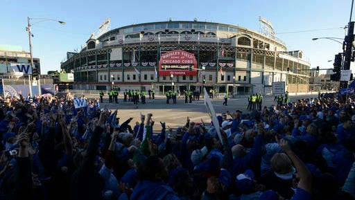 Fans line up outside Wrigley Field for the start of the parade honoring the World Series champion Chicago Cubs baseball team Friday, Nov. 4, 2016, in Chicago.