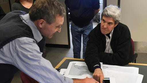 U.S. Secretary of State John Kerry, right, listens to scientist John Snow about the increased movement of icebergs across Antarctica at the Crary Science and Engineering Center, McMurdo Station in Antarctica Saturday, Nov. 12, 2016. Kerry who became the highest-ranking American official to visit Antarctica when he landed for a two-day trip on Friday didn't comment on Donald Trump's election victory while visiting Antarctica, but did say that citizens who care about limiting emissions might have to march in the streets to push for more aggressive action.