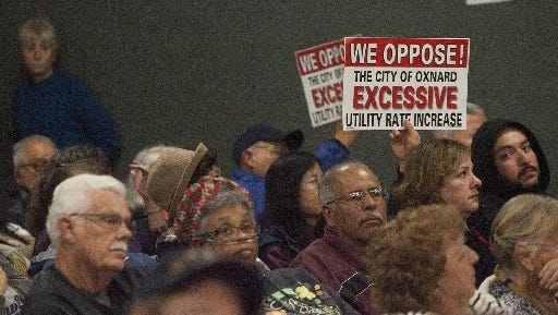 Residents show disapproval of wastewater rate increases during an Oxnard City Council meeting earlier this year. With the passage of Measure M, the city faces some dire financial circumstances.