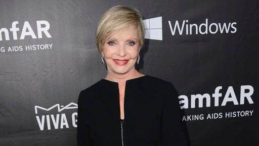 """FILE - In this Oct. 29, 2014 file photo, Florence Henderson arrives at the 2014 amfAR Inspiration Gala at Milk Studios in Los Angeles. Henderson, the wholesome actress who went from Broadway star to television icon when she became Carol Brady, the ever-cheerful mom residing over """"The Brady Bunch,"""" has died at age 82. She died surrounded by family and friends, her manager, Kayla Pressman, said in a statement late Thursday, Nov. 24, 2016."""