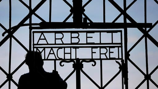 "FILE In this April 29, 2015 file picture a  blacksmith prepares a replica of the Dachau Nazi concentration camp gate, with the writing ""Arbeit macht frei"" (Work Sets you Free) at the main entrance of the memorial in Dachau, Germany,. German police say Friday Dec. 2, 2016 the wrought-iron gate to the Nazis' Dachau concentration camp that was stolen two years ago appears to have been found in western Norway."