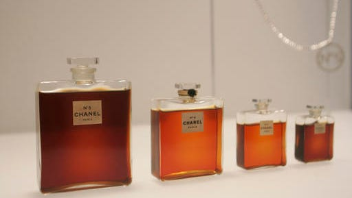 FILE - In this May 2, 2005 file photo, bottles of Chanel No. 5 perfume are displayed at the Metropolitan Museum of Art's Costume Institute exhibit in New York. Chanel is making a stink over a possible high-speed train line through jasmine fields in Provence, warning it could threaten production of its Chanel No. 5 perfume.