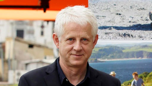 """FILE - In this Oct. 21, 2013 file photo, British director Richard Curtis, founder of Red Nose Day, poses for the photographers as he present his latest movie """"About Time"""" , in Rome. Comic Relief, Inc. announced Thursday, Jan. 26, 2017, that the 2017 fundraising efforts will culminate with the Red Nose Day TV special on May 25."""