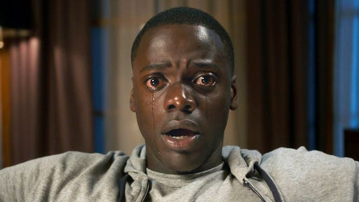 """This image released by Universal Pictures shows Daniel Kaluuya in a scene from, """"Get Out."""" Jordan Peele's thriller sensation """"Get Out"""" crossed $100 million over the weekend, reaching that milestone in just 16 days. It's a staggering result for a film that, though it cost less than $5 million to make, has become a cultural sensation."""