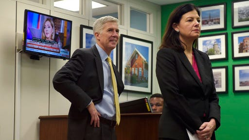 FILE - In this Feb. 16, 2017 file photo, Supreme Court Justice nominee Neil Gorsuch and former New Hampshire Sen. Kelly Ayotte wait for a meeting with Sen. Chris Murphy, D-Conn. on Capitol Hill in Washington. By the time a lawsuit over pollution from a nuclear weapons plant had reached Judge Neil Gorsuch, it had crawled through the courts for more than two decades, outliving some of the landowners who said the contamination destroyed their property values. The pace of the litigation didn't sit well with Gorsuch, a judge for the Denver-based 10th U.S. Circuit Court of Appeals, and now a nominee for the U.S. Supreme Court.