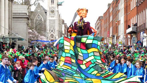 An artistic team from the Irish county of Wexford carries a massive rainbow tapestry in the St. Patrick's Day parade in Dublin, Ireland, on Friday, March 17, 2017. An estimated half million tourists and Dubliners watched the parade, the focal point for a four-day festival that marks the start of Ireland's tourist season.