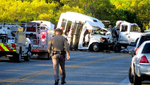 Authorities investigate after a deadly crash involving a van carrying church members and a pickup truck on U.S. 83 outside Garner State Park in northern Uvalde County, Texas, Wednesday, March 29, 2017. The group of senior adults from First Baptist Church of New Braunfels, Texas, was returning from a retreat when the crash occurred, a church statement said.