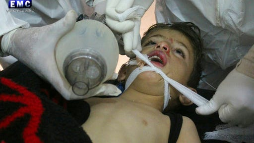 This photo provided Tuesday, April 4, 2017 by the Syrian anti-government activist group Edlib Media Center, which has been authenticated based on its contents and other AP reporting, shows  Syrian doctors treating a child following a suspected chemical attack, at a makeshift hospital, in the town of Khan Sheikhoun, northern Idlib province, Syria. The suspected chemical attack killed dozens of people on Tuesday, Syrian opposition activists said, describing the attack as among the worst in the country's six-year civil war.