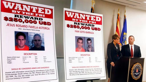 FILE - In this July 9, 2012, file photo, with wanted posters off to the side, Laura E. Duffy, United States Attorney Southern District of California, and FBI Special Agent in Charge, James L. Turgal, Jr., right, announce the indictments on five suspects involved in the death of U.S. Border Patrol agent Brian Terry in Tucson, Ariz. Mexican authorities have arrested the suspected shooter in the 2010 killing of Terry, whose death exposed a bungled gun-tracking operation by the federal government. In a joint statement issued by Mexico's navy and its federal Attorney General's Office on Thursday, April 13, in Mexico City that the suspect who's name wasn't released in Terry's death was arrested near the border between the states of Sinoloa and Chihuahua, a mountainous region note drug activity.