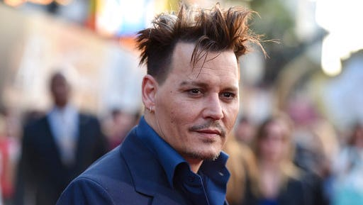 """FILE - In this May 23, 2016, file photo, Johnny Depp arrives at the premiere of """"Alice Through the Looking Glass"""" at the El Capitan Theatre in Los Angeles. Some visitors to the Pirates of the Caribbean ride at California's Disneyland got a surprise Wednesday, April 26, 2017, when Depp appeared as Captain Jack Sparrow inside the ride."""