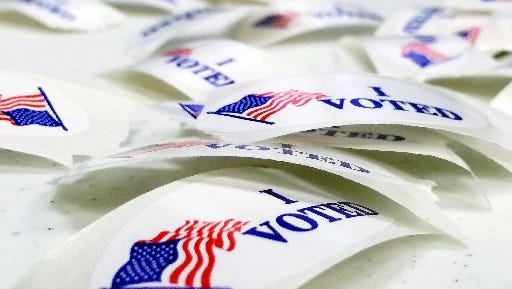 """""""I VOTED"""" stickers lie on a table at the Norton Shores Library in Norton Shores on Nov. 4, 2014."""