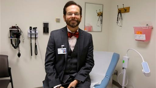 Dr. Robert Palinkas, director of the McKinley Health Center at the University of Illinois, poses in an exam room in Urbana, Ill., Thursday. Extra health checks are part of protocols campuses throughout the United States have in place as they prepare for as many as 10,000 students from Nigeria, Guinea, Liberia and Sierra Leone, where more than 1,000 people have died in the worst Ebola outbreak in history.