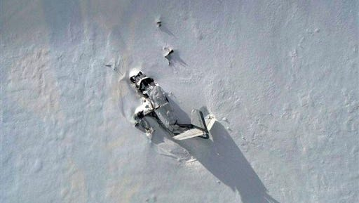 This photo provided by the Park County, Wyo., Sheriff?s Office shows the wreckage of a single-engine plane on a rugged, snowy mountain outside of Yellowstone National Park Monday, May 12, 2014. The Park County Sheriff's Office says two elderly brothers on board the plane are presumed dead. (AP Photo/Park County Sheriff's Office)