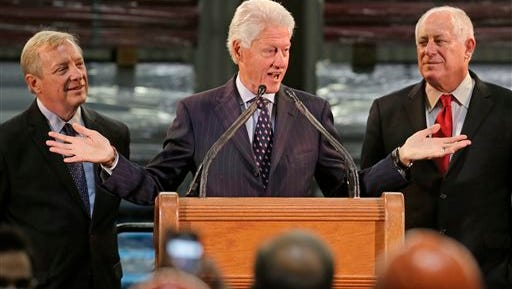 Former President Bill Clinton appears with U.S. Senator Dick Durbin, left, and Illinois Gov. Pat Quinn as they address workers, labor leaders and business leaders at Wheatland Tube Co., Tuesday, Oct. 21, 2014, in Chicago.