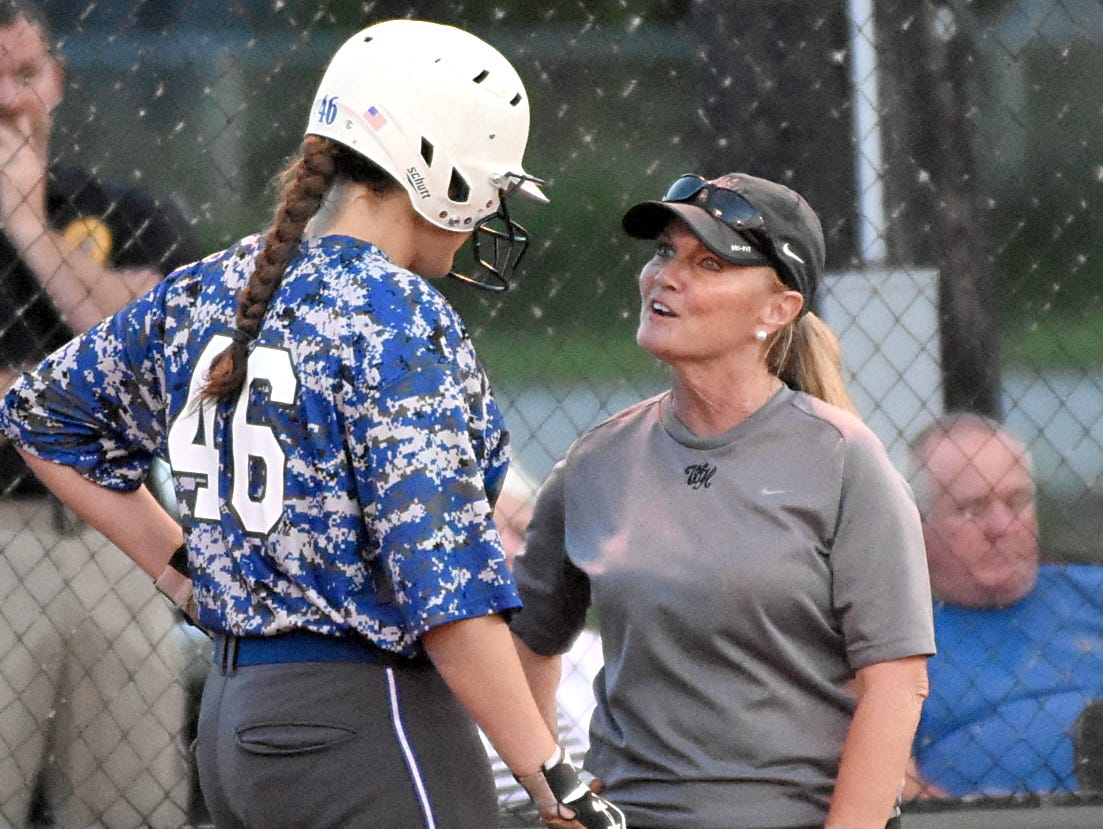 White House High head softball coach Cindy Towers talks with freshman Mallory Gut prior to her fourth-inning at-bat during Wednesday evening's 6-2 loss to Greenbrier.