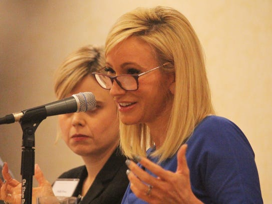 Paula White speaks at a panel for the Religion News