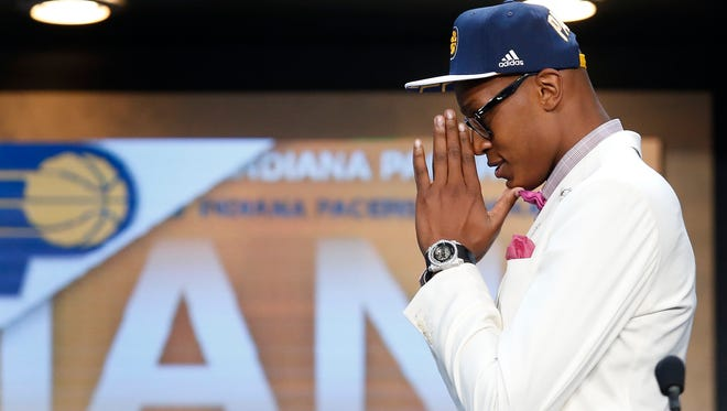 Myles Turner reacts after being selected 10th overall by the Indiana Pacers during the NBA basketball draft, Thursday, June 25, 2015, in New York. (AP Photo/Kathy Willens)