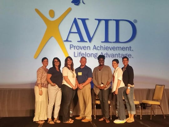 Representatives of Fort Myers Middle Academy attended the AVID Summer Institute recently. From left on stage are Denise Fitzpatrick, the assistant principal of curriculum; language arts teachers Andrea DeShazo and Marissa Micciulli; Principal Ronald Schuyler; language arts teachers Kindra Pinnace and Lisa Alexander; and Toni Washington-Knight, the assistant principal.