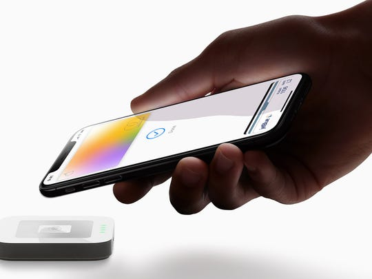 Person using Apple Pay contactless payments