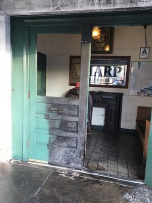 The front doors of the Irish Rover in Clifton were set ablaze early Thursday morning.