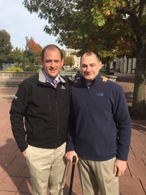 Rep. Andy Barr, left, and Cpl. Matthew Bradford pose for a picture.