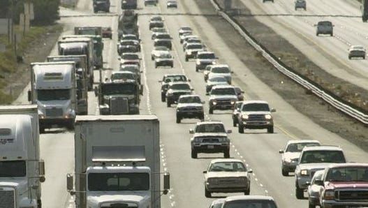 Traffic is backed up from Blythe to Indio after three trucks overturned