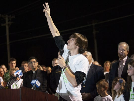 Marcus Grimmie gestures while speaking during a candlelight