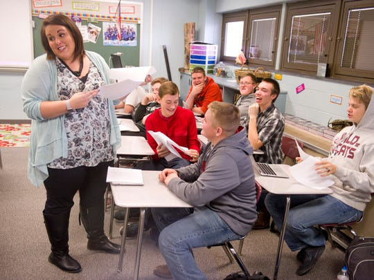 English teacher Katie Bushard goes over a student's research paper during a recent class at Mount Vernon High School.