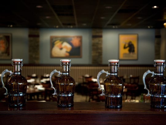 Growlers are displayed at Carolina Blue in Pitman.