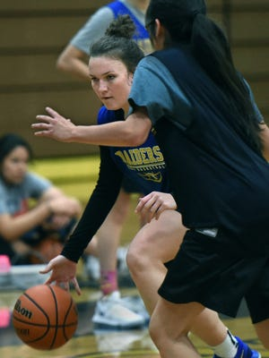 Reed's Taylor Johnson dribbles the ball during practice at the Reed gym on Jan. 2, 2017.