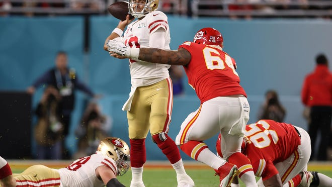 San Francisco 49ers quarterback Jimmy Garoppolo (10) gets pressured by Kansas City Chiefs defensive tackles Chris Jones (95) and Mike Pennel (64) during Super Bowl LIV on Feb. 2 at Hard Rock Stadium in Miami Gardens, Florida.