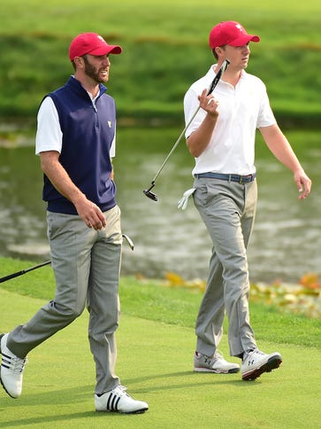 Jordan Spieth (R) and Dustin Johnson of the United
