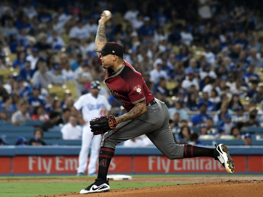 Diamondbacks starter Taijuan Walker throws against