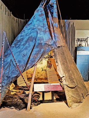 A buffalo hide tipi on display at Frontier Texas.