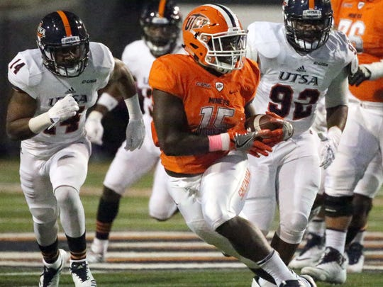 UTEP running back Kevin Dove, 15, finds room to run