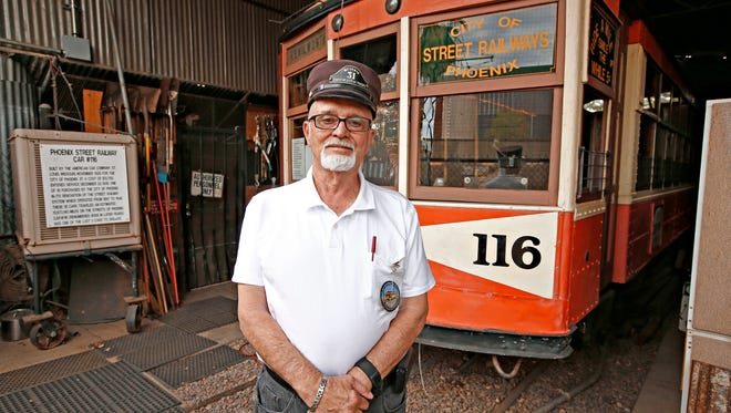Ernie Workman, president of the Phoenix Trolley Museum in downtown Phoenix, and the refurbished 116 street car on February 18, 2016.