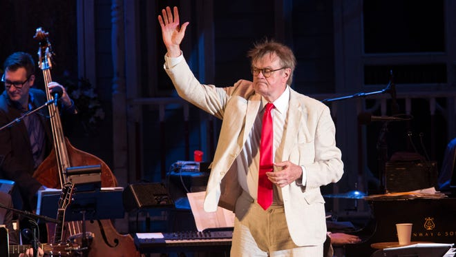 Garrison Keillor gives a final wave before walking off the Hollywood Bowl stage.