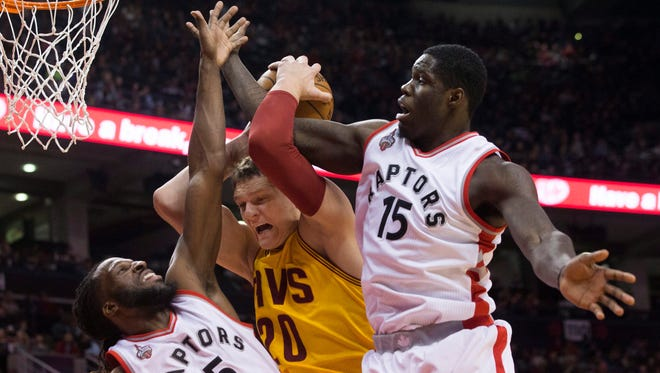 The Toronto Raptors' Anthony Bennett, right, plays against the Cleveland Cavaliers on Oct. 18, 2015.
